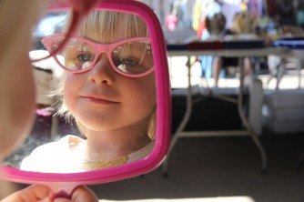 Olivia trying out glasses at the French market - how are these looking?