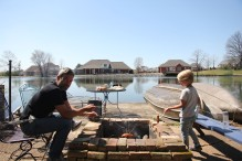 Grilling sausages over the bond fire in Dyersburg, Tennessee