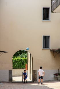 To boys playing soccer in a village in Ticino